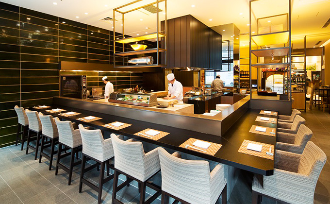 Enjoy observing the chefs' skills up-close, from the counter seats.